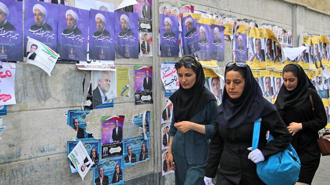 Les Iraniens choisissent leur président: le modéré Rohani, artisan de l'accord nucléaire, ou le conservateur Raissi?